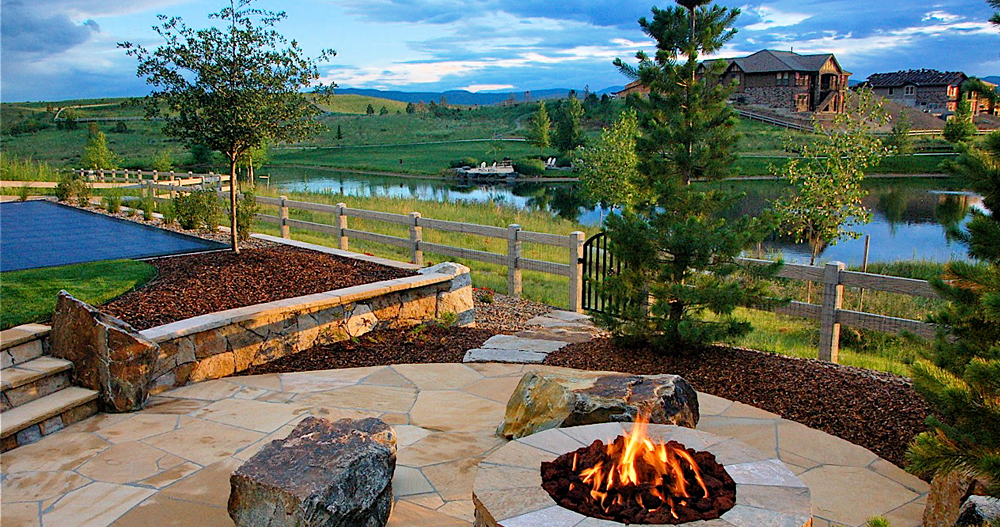 Outdoor-Hardscape-With-Stones-Landscaping-and-Fireplace