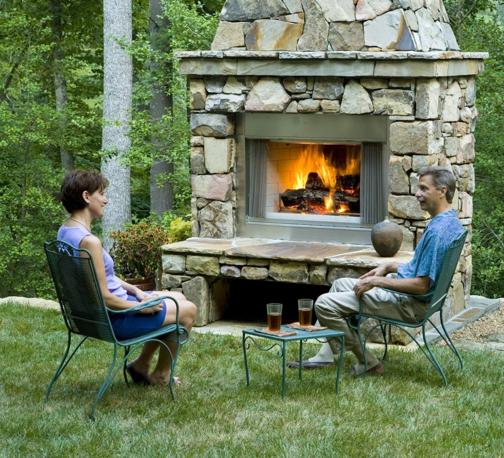 Outdoor fireplace with people in North Va