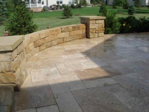 flagstone-patio-with-retaining-wall-and-garden